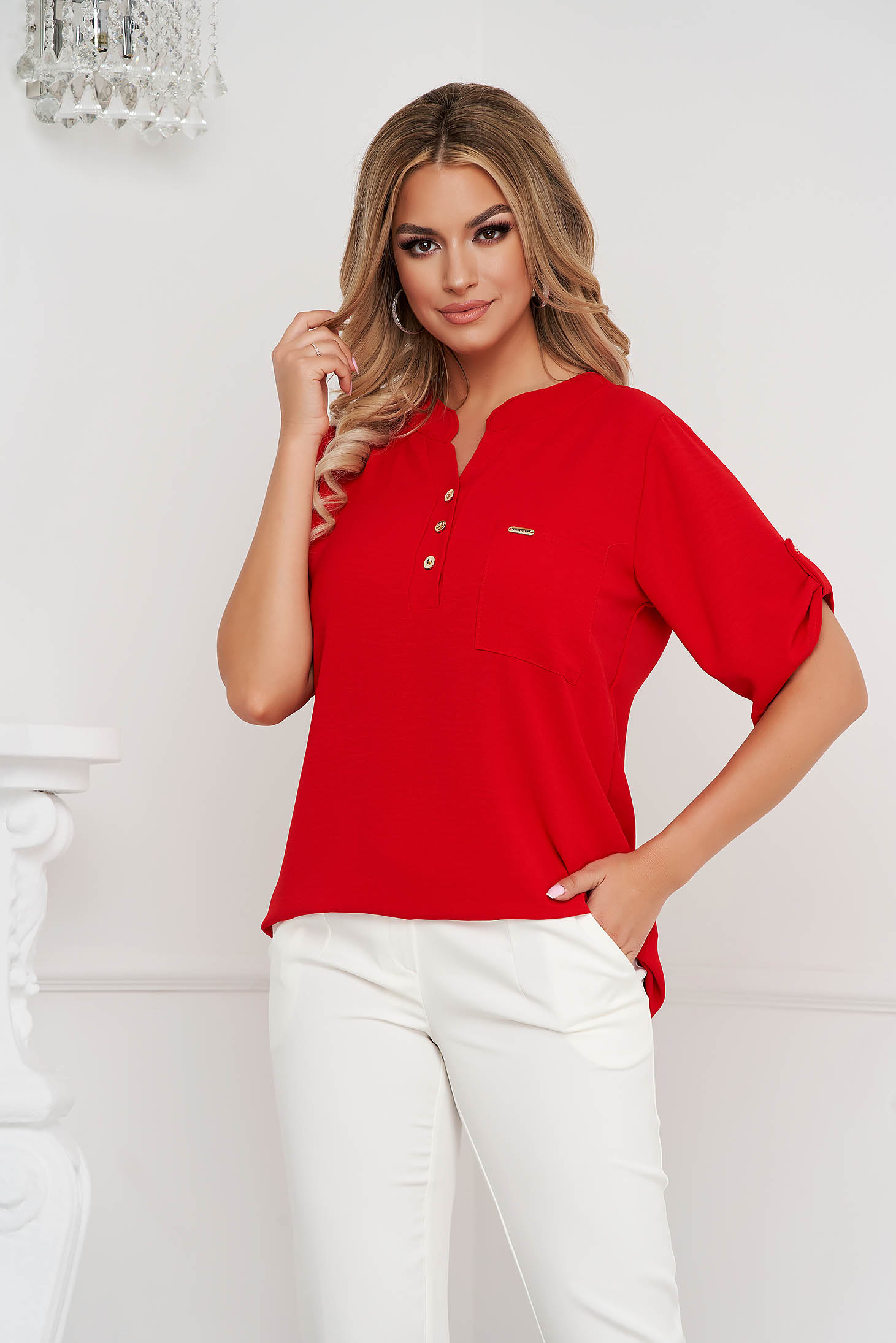 Red women`s blouse loose fit wrinkled material a front pocket