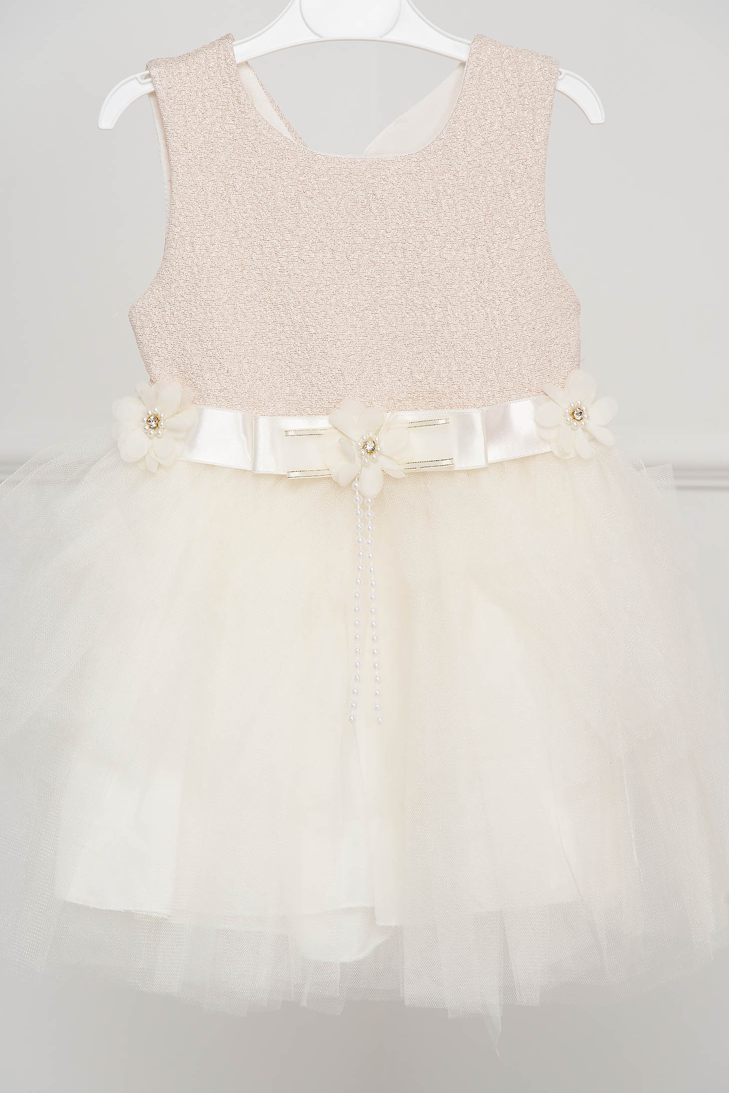 Ivory dress occasional cloche from tulle accessorized with breastpin