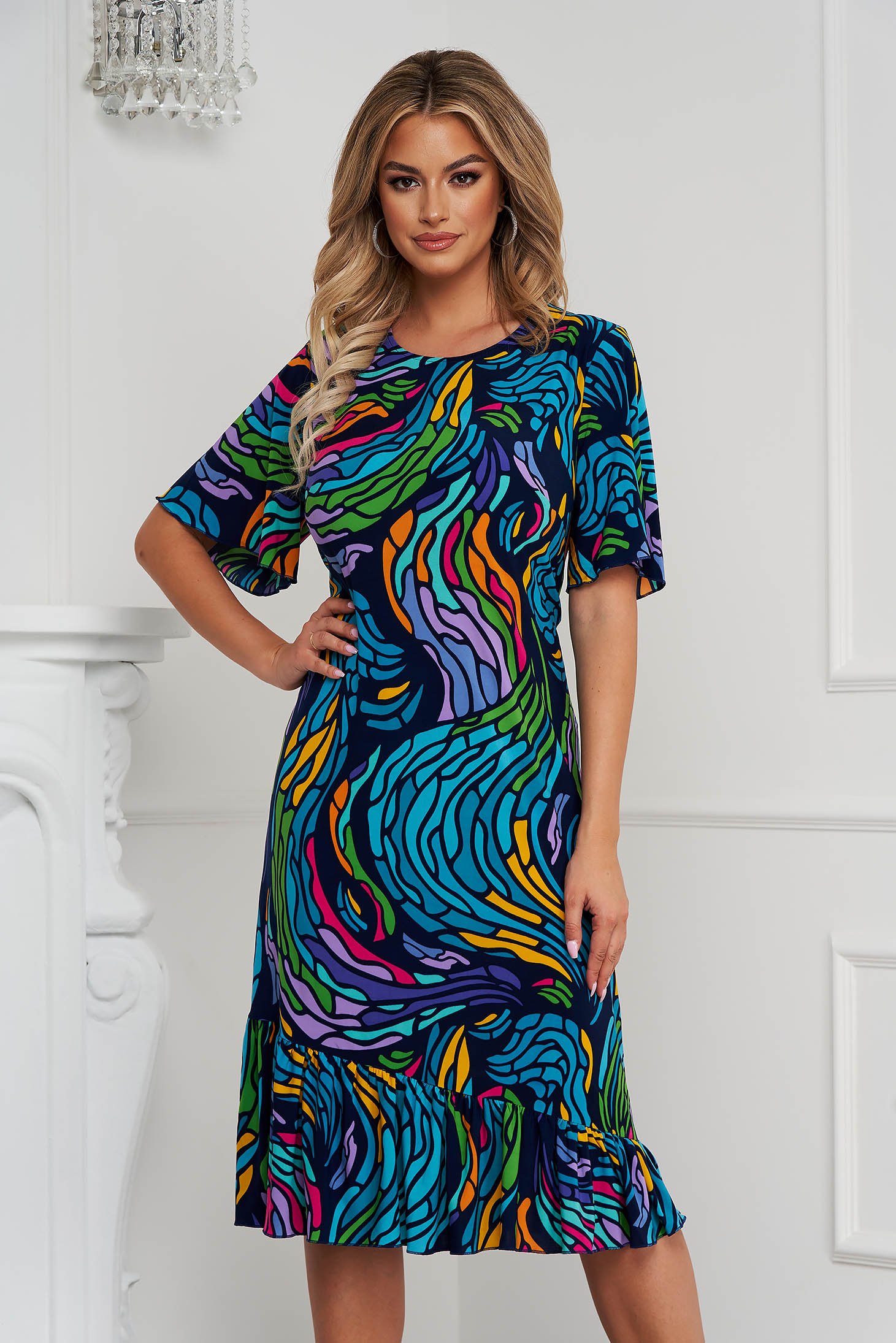 Dress office straight from elastic fabric with ruffles at the buttom of the dress