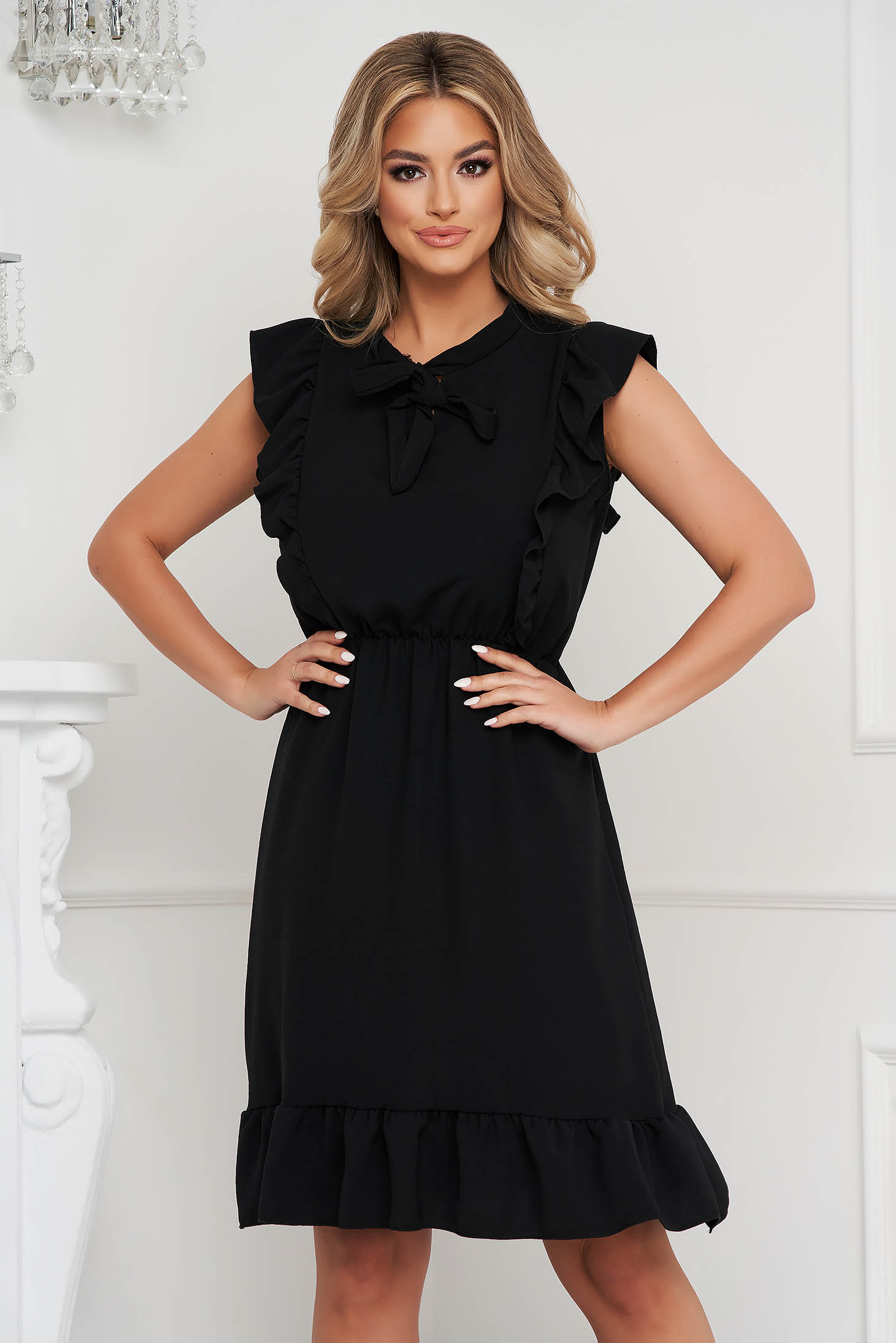 Black dress short cut cloche with elastic waist airy fabric with ruffle details