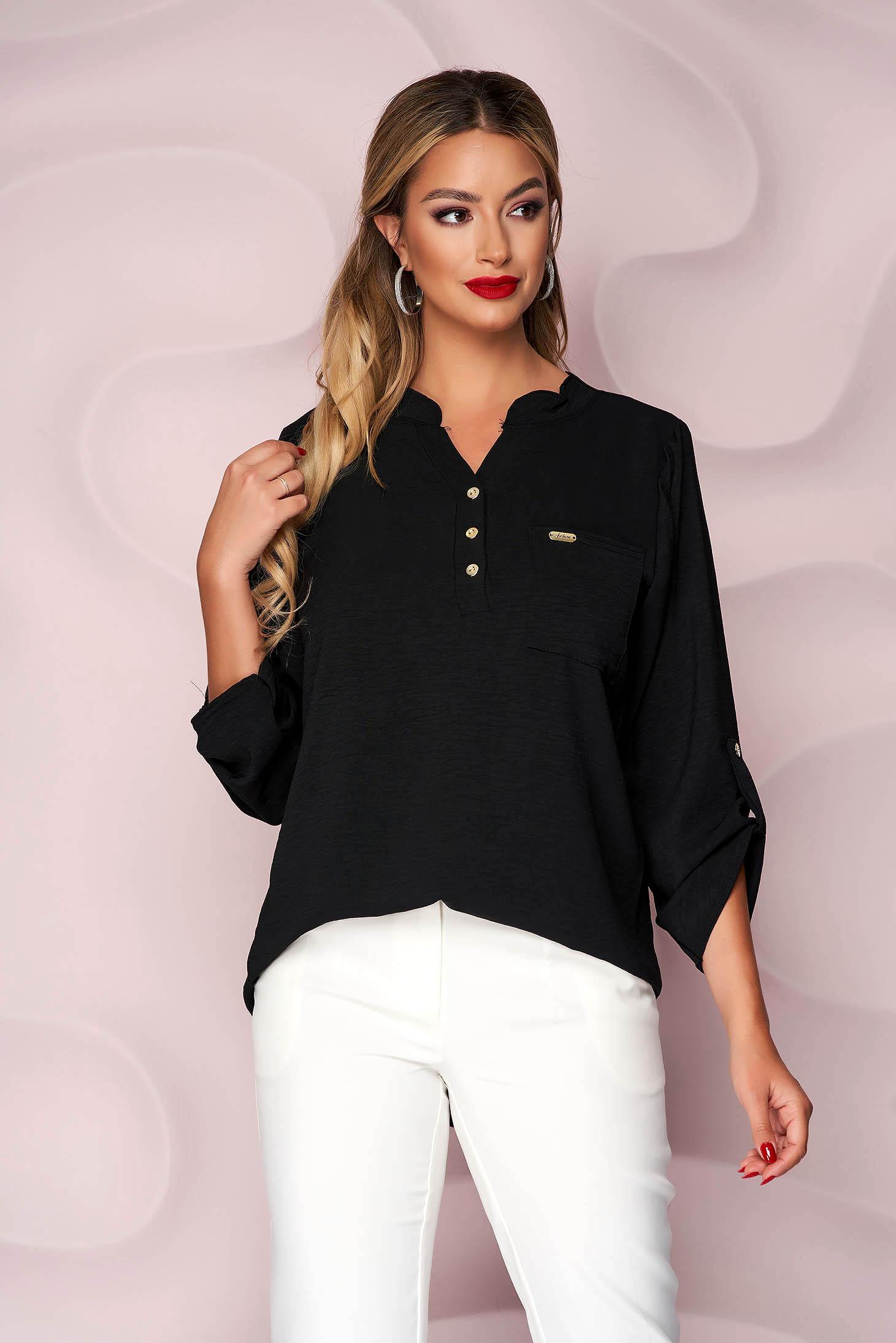 Black women`s blouse loose fit wrinkled material a front pocket