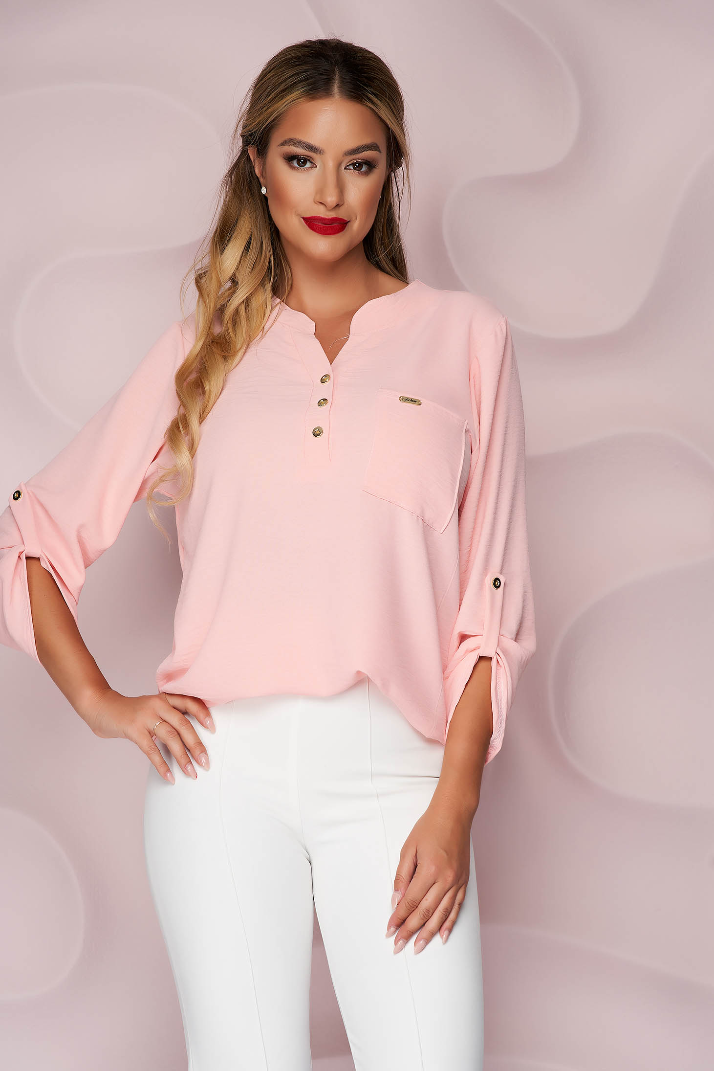 Pink women`s blouse loose fit wrinkled material a front pocket