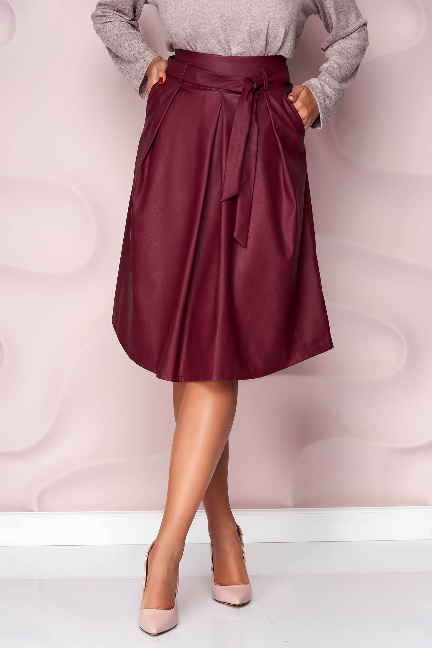 Burgundy skirt midi cloche office from ecological leather from elastic fabric accessorized with tied waistband