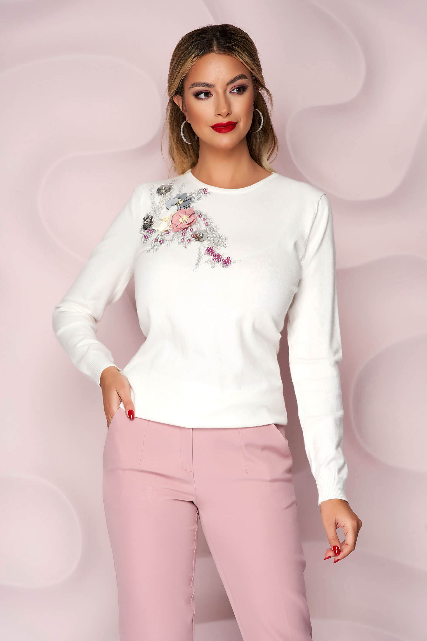 White women`s blouse knitted loose fit with raised flowers with 3d effect