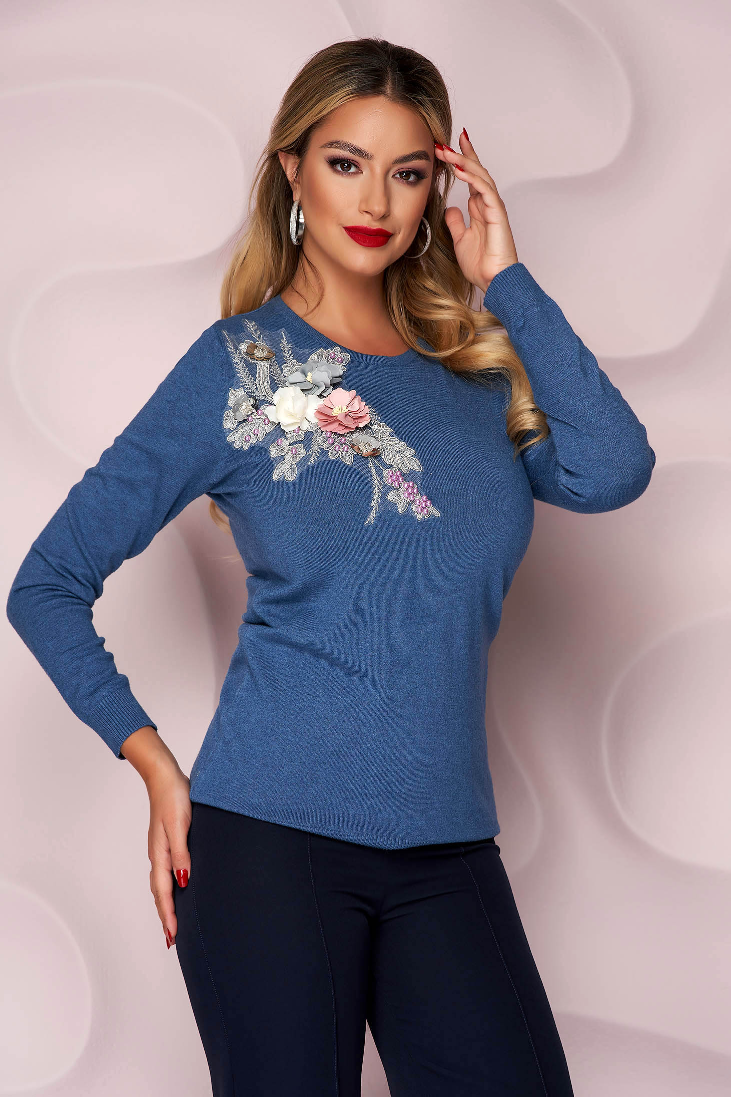 Blue women`s blouse knitted loose fit with raised flowers with 3d effect