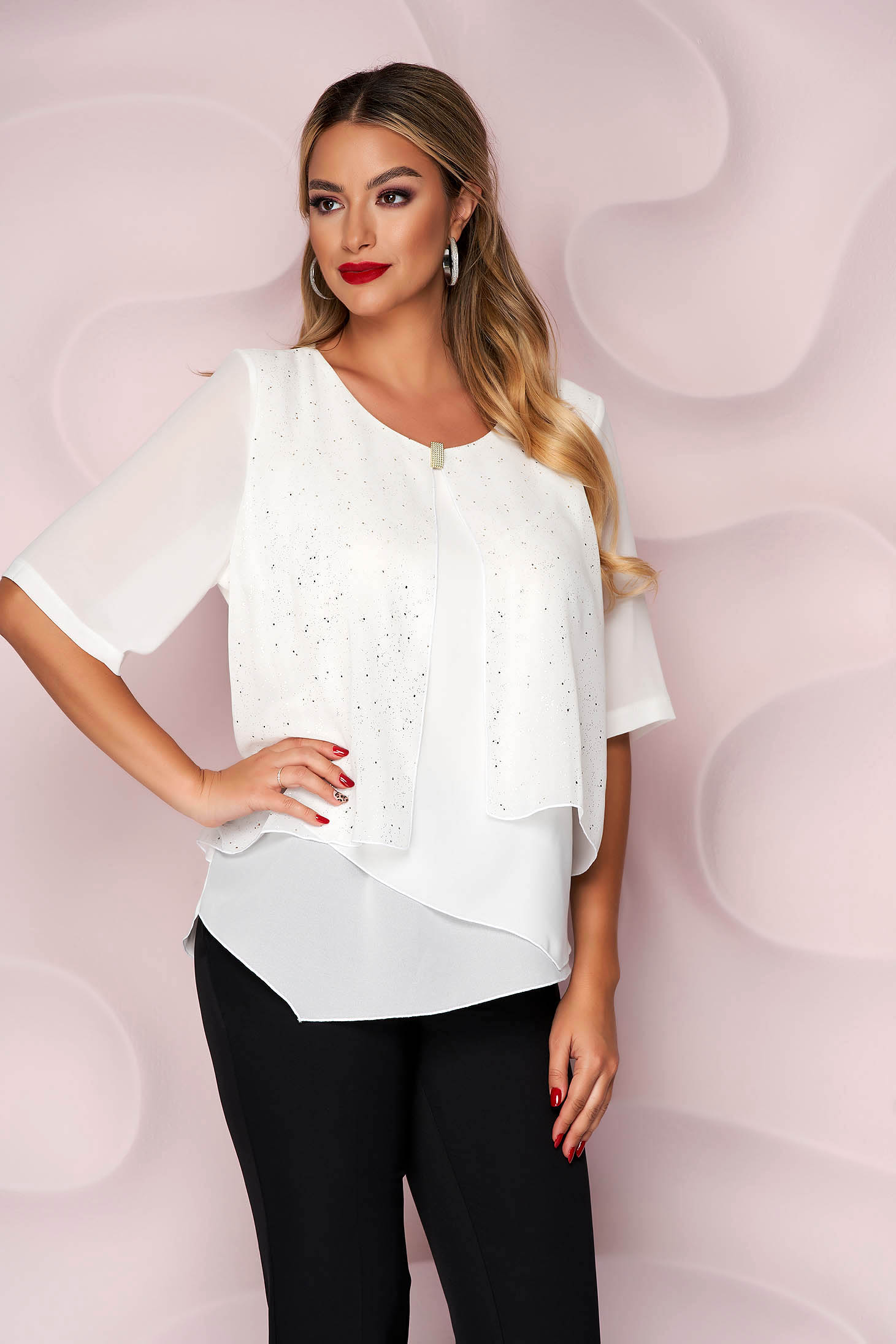 White women`s blouse loose fit thin fabric from veil fabric accessorized with breastpin asymmetrical office