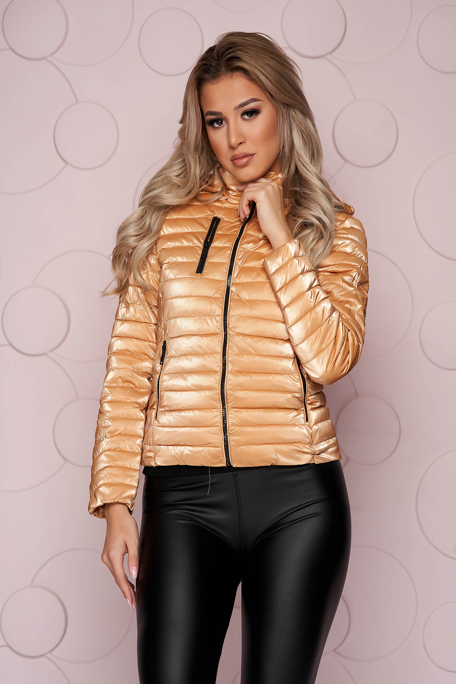Gold jacket short cut from shiny fabric detachable hood arched cut