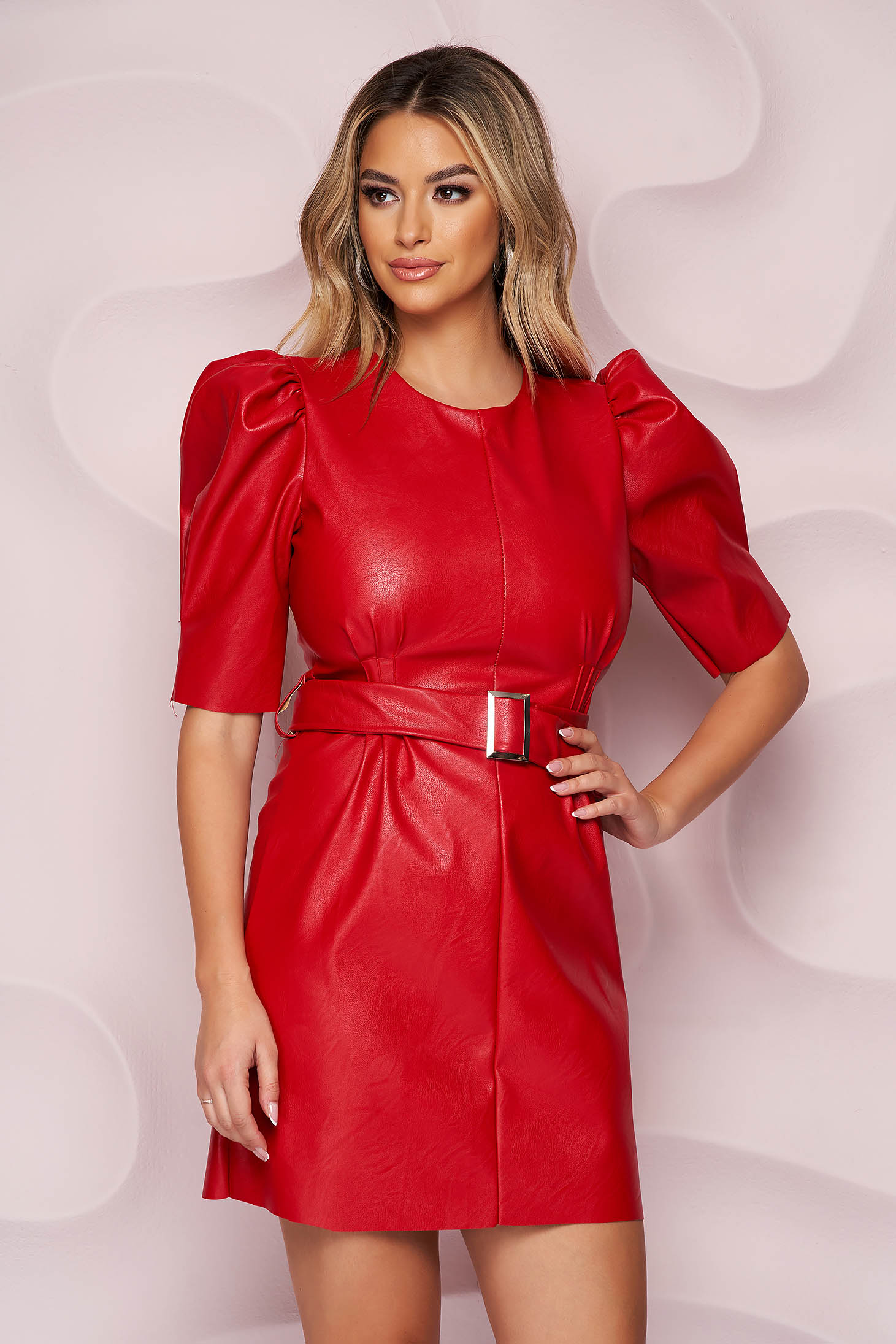 Red dress from ecological leather accessorized with belt with puffed sleeves short cut straight